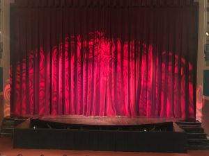 Red theatre curtain with lighting effect
