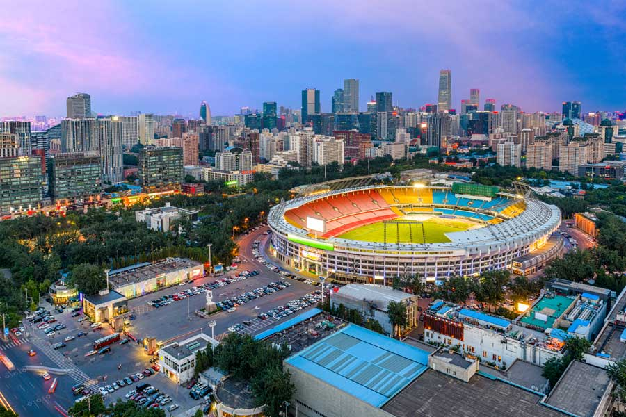 Sports arena in front of cityscape