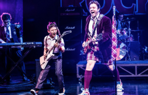 A photo of Dewey and the guitarist in School of Rock, the musical